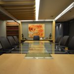 GAGNON & BRUNET AVOCATS : built-in cabinet and conference table, black glass featured wall, maple ceiling beam and post