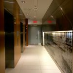 EVOLO 1 : elevator lobby, teak and stainless steel panels