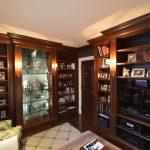 Mahogany wood den, crown molding, crotch mahogany doors and white lacquer frames