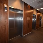 EVOLO 2 : elevator lobby walnut wall panels