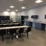 DOLLARAMA DISTRIBUTION CENTER : built-in cafeteria cabinets and solid surface counter